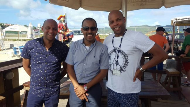 Greg and Mike Mckenzie, twin hosts of the BBC Travel Show with St. Maarten's Head of Tourism Rolando Brison.