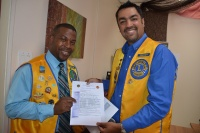 Sint. Maarten Lions Club President Lion Sunil Khatnani (on right) and Club Treasurer Lion Alphons Gumbs show the letter that was delivered to the Government of Sint. Maarten and it's Head of State the Honorable Prime Minister Sarah Wescot-Williams. This letter was delivered on International Youth Day, Wednesday August 12th 2014.