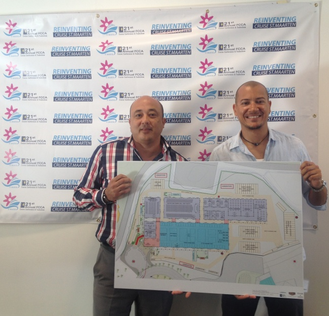 Port St. Maarten Chief Executive Officer Mark Mingo welcoming Nature Foundation Director Tadzio Bervoets who will be one of the participants in the St. Maarten Village Pavilion Booth. Both of them are holding the layout map for the convention center.