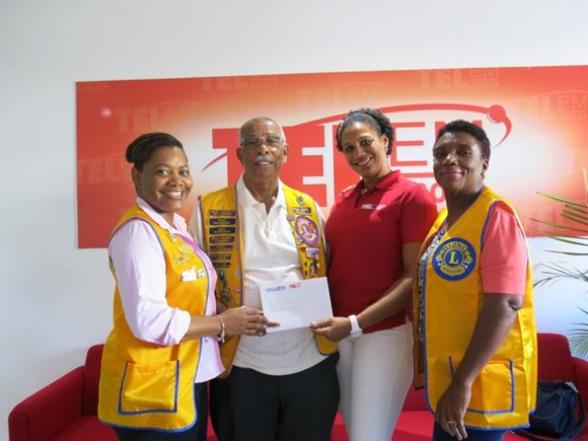 Lion Wally Havertong (2nd left) and fellow Lions Jeniffer Johnson (left) and Oralie Boirard (right) receive a sponsorship check from TelEm Group Manager, Marketing & Sales Grisha Marten (2nd right).