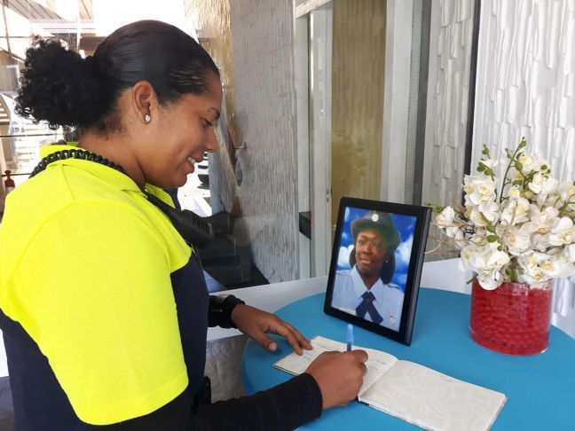 Police colleague Rachel Martina is seen signing the condolence book. (Photo contributed)