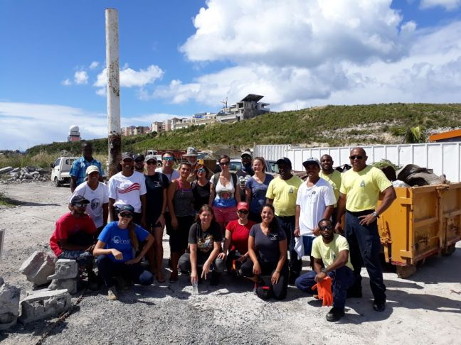 Some of the volunteers and the St. Maarten Coast guard during the Lagoon cleanup event.