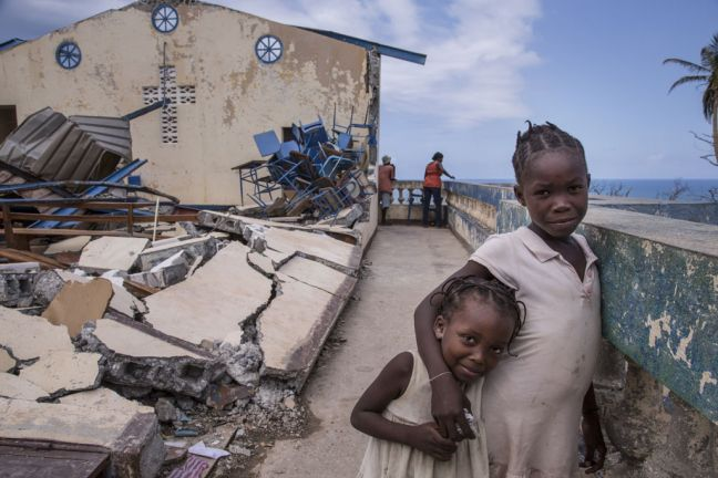 In Jérémie, Haiti, children play at the Église Chrétienne Nan Lindy. Hundreds of people have sought temporary shelter at the church after countless homes were destroyed by Hurricane Matthew. Photo: UNICEF/UN035877/LeMoyne