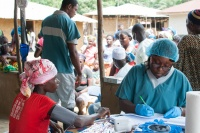 In Ebola-affected Liberia, the International Organization for Migration (IOM) set up this mobile clinic to provide basic healthcare services to about 1400 people in Gbaigbon and neighbouring communities in Bomi County. Photo: UNMEER/Simon Ruf