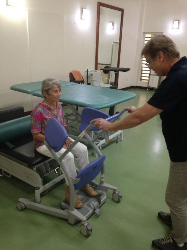 Island Gems member Liz Maidwell is shown how the Sara Stedy lift is used to help residents of St. Martin Home out of bed.