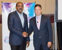 Hon. Gaston Browne, Prime Minster of Antigua & Barbuda with John Reid,  CEO C&W Communications