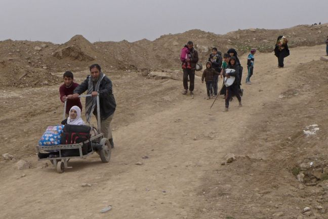 In Mosul, Iraq, aging family members are pushed for hours through frontline fighting between the army and the Islamic State of Iraq and the Levant (ISIL/Da'esh), to reach safety. Photo: IRIN/Tom Westcott
