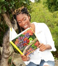 University student Ariane Jasor Glisa-Vandepul is a fan of Lizzy Lizard and models the St. Martin storybook by Robin Boasman for the island's annual book fair. (CLF Photo)
