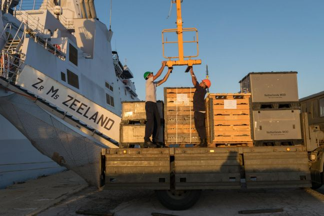 Disaster relief and recovery supplies being on-loaded one of the Dutch Naval vessels, the Zeeland.