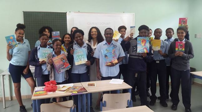MPC students holding books of author Loekie Morales (in the middle).