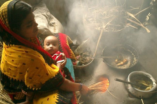 Mother and baby next to a traditional cook stove in Bangladesh. World Bank/Prabir Mallik