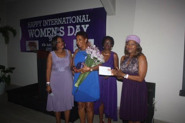President of the Peridot Foundation Gracita Arrindell (right) along with guests at the event on Friday.