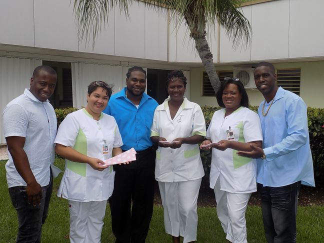L to R: Julian Rollocks Jr., Nurse Moi Portal, Melvin Austrie, Nurse Yvonne Cameron, Nurse Sherryl Carty-Fleming and Bryan Barry.