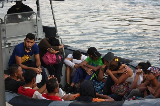 29 Venezuelan nationals being transported to shore.