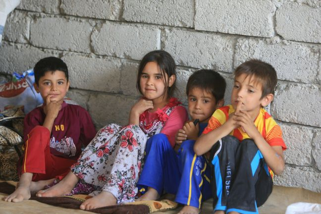 Iraqi refugee children who fled from Tal Afar and found shelter in schools, mosques and unfinished buildings in the area of Sinjar, in Ninawa governorate. Photo: Iraqi Red Crescent/UNOCHA