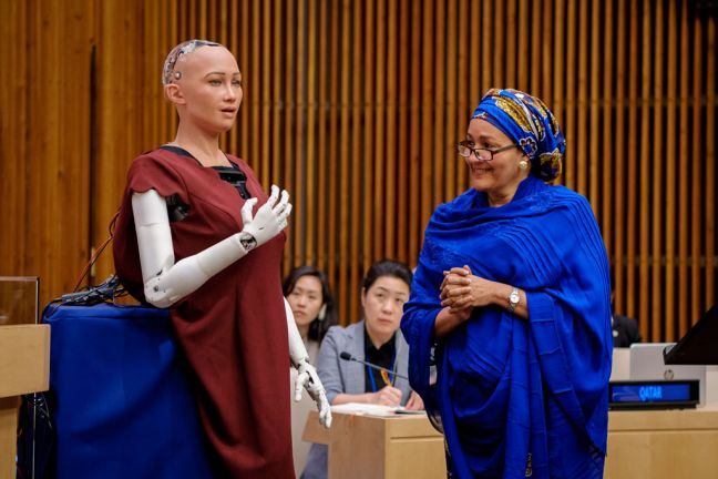 "Deputy Secretary-General Amina Mohammed has a brief dialogue with Sophia at the ""The Future of Everything – Sustainable Development in the Age of Rapid Technological Change"" meeting. UN Photo/Manuel Elias"