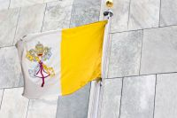 The flag of the Holy See flying at the United Nations headquarters in New York. UN Photo/Loey Felipe