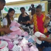 Tzu Chi donates relief items to Pond Island residents