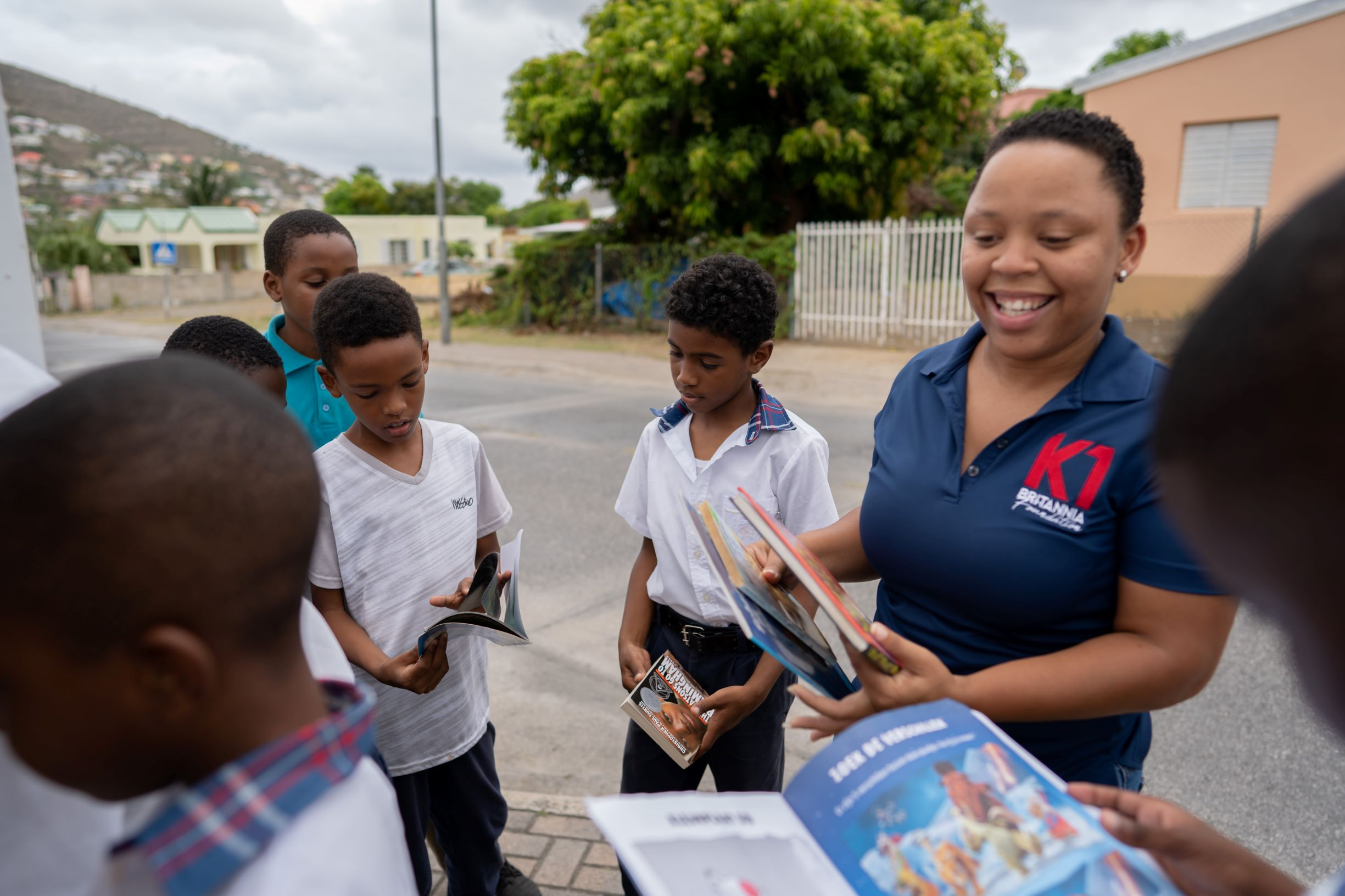 K1 Project Manager Chiaira Bowers explaining to the children how the little library works