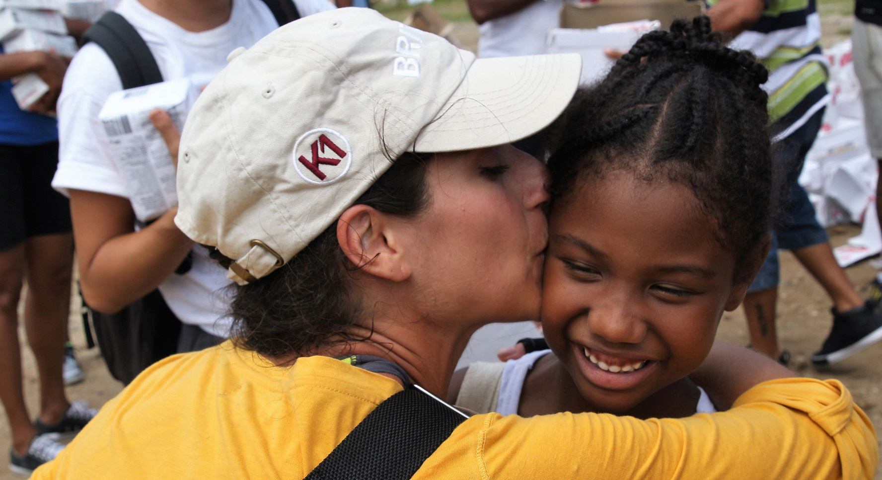 K1 volunteer enjoying a sweet moment during a distribution