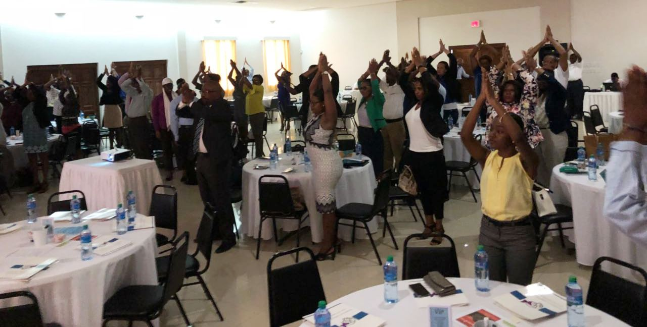 Participants engaged in body mind wake up from Clara Reyes
