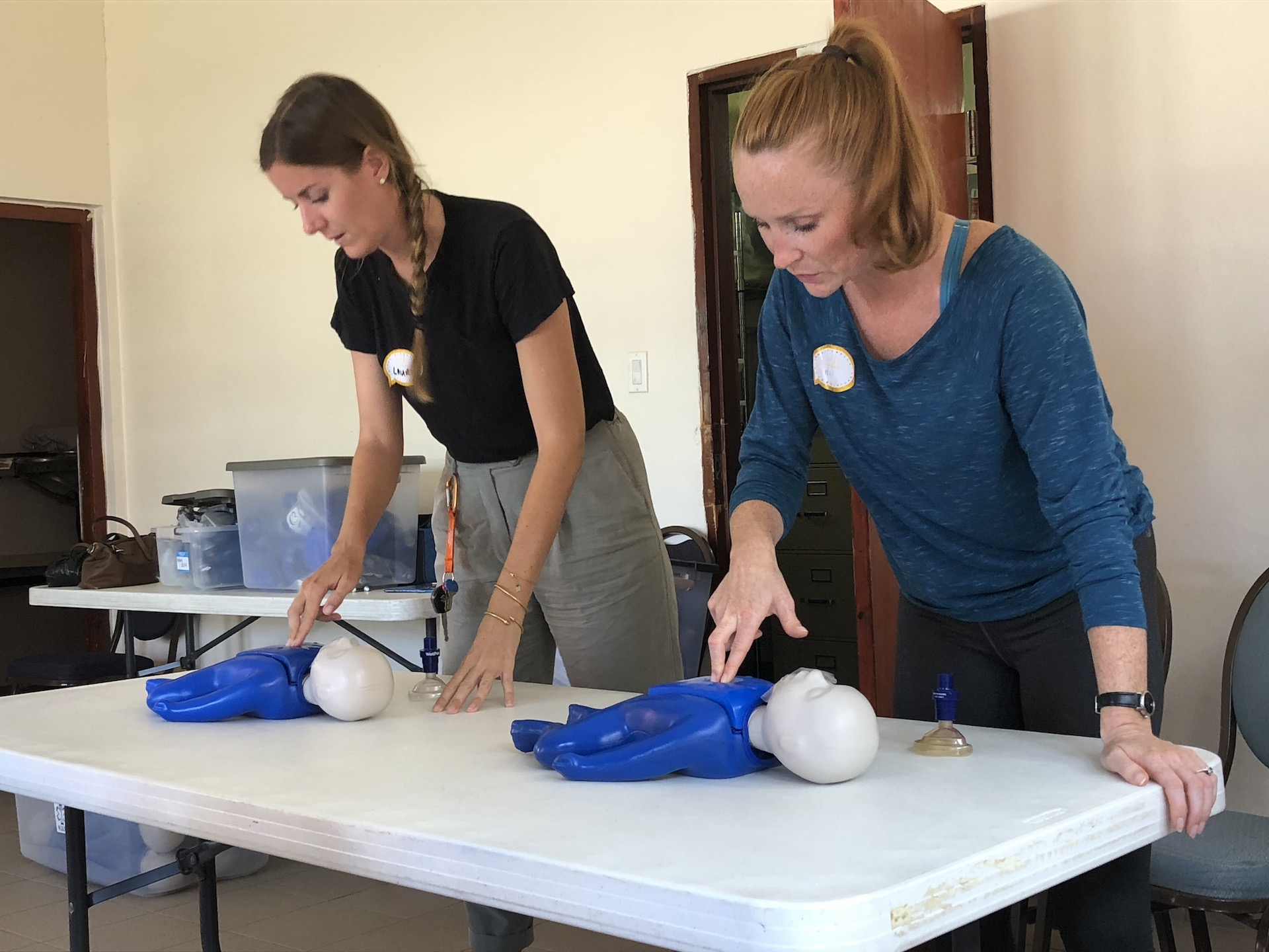 Photo 3 K1 DIRECT Volunteers practice CPR on infants during training