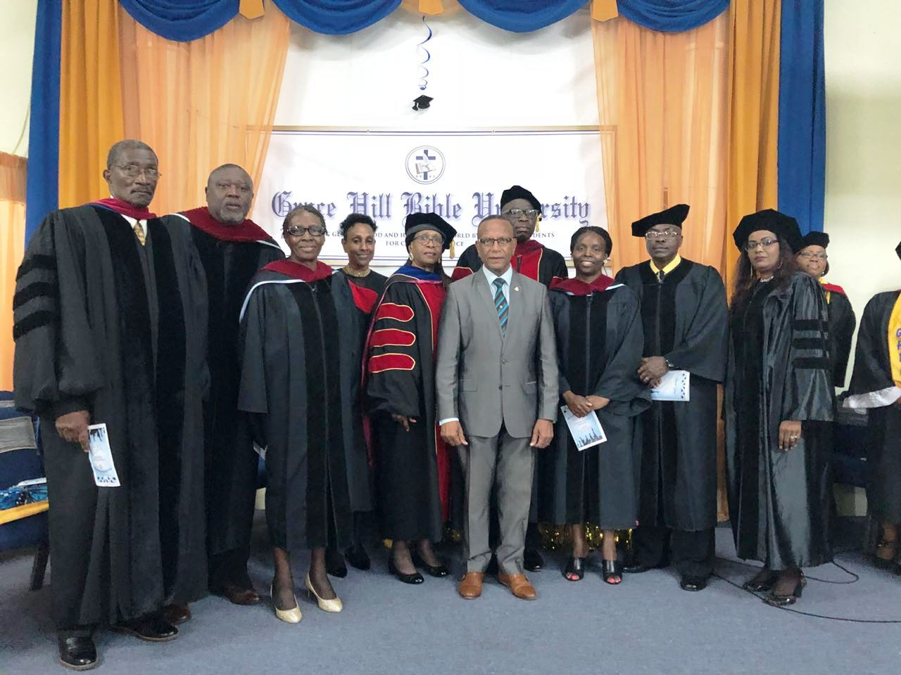 The former minister of education Wycliffe Smith with faculty and staff of GHBU at 2018 commencement