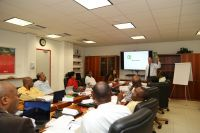 Corporate Governance expert, Prof. Frank Kunneman, leads off discussion in a joint session with the Supervisory Board of Directors, St. Maarten Telecommunication Holding Company N.V. and the TelEm Group management team, during a training session November 26, 2018.