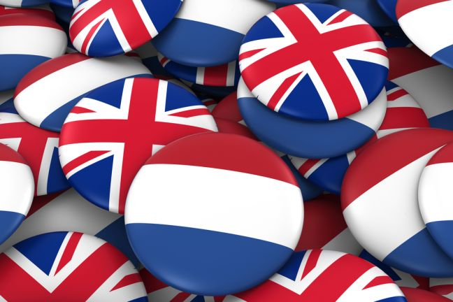 Netherlands and UK Badges Background – Pile of Dutch and British Flag Buttons 3D Illustration