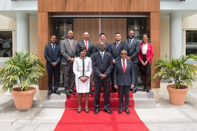 His Excellency Governor Eugene Holiday and members of the Council of Ministers headed by Prime Minister Leona Romeo Marlin.