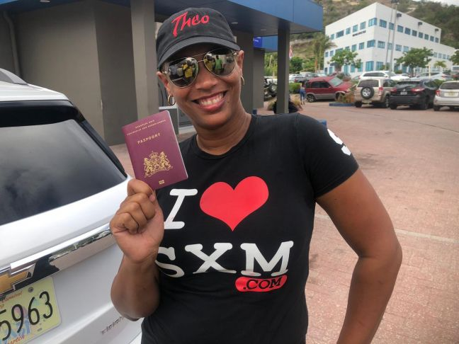 The wife of suspended MP Theo Heyliger, Grisha Heyliger-Marten holding her husbands passport. (Photo contributed)