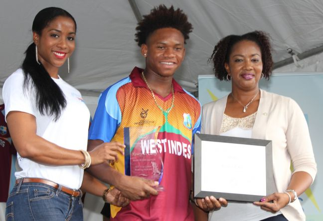 File Photo: L-R - Yoly Hawley Sports Ambassador & IFBB Bikini Pro, Keacy Carty West Indies U19 and Minister of Sport Silveria Jacobs. (Photo contributed)