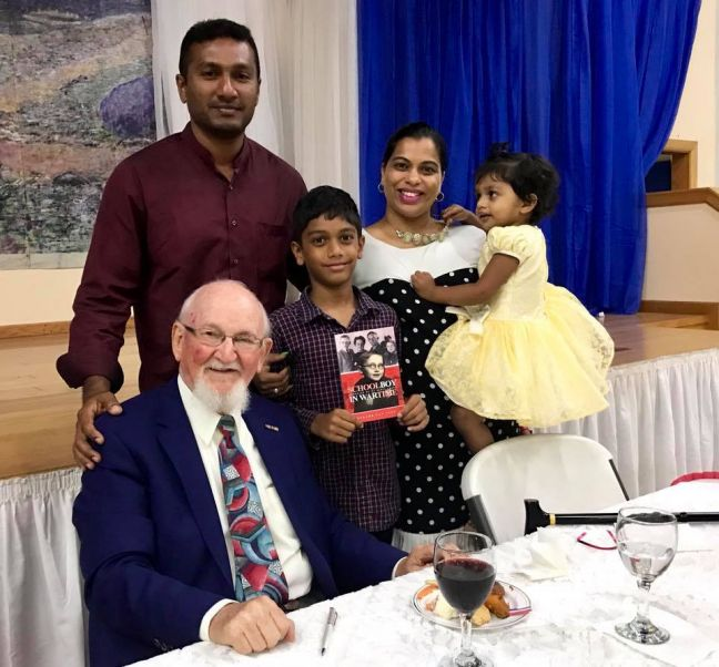 Well-known St. Martin author Gerard van Veen (L) with guests Roy Fernandes (2nd L) and the Fernandes family at book party for Schoolboy in Wartime. (Photo courtesy G. van Veen.)