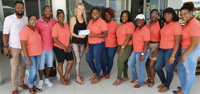 Owner of Joga SXM Jolanda Dejong, President Jaida Nisbett, and members of Rotary Sunset.
