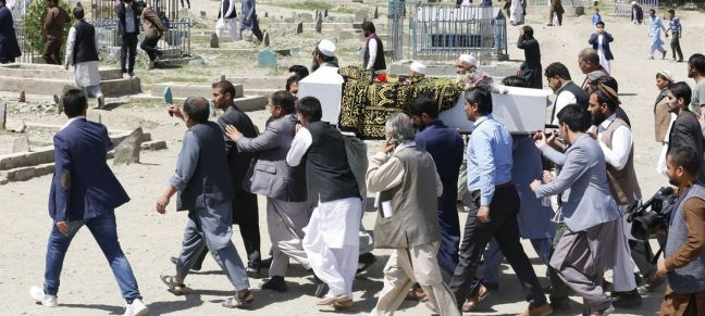 Fardin Waezi/UNAMA Funeral of civilian killed in a suicide attack in Kabul, Afghanistan, June 2018. The UN mission in the country has reported that a record number of Afghan civilians were killed by warring parties in the first half of 2018
