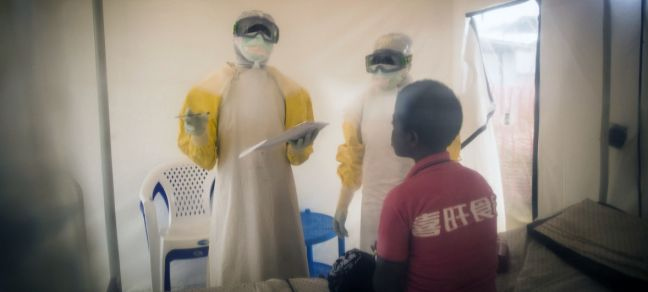 World Bank/Vincent Tremeau Health Workers treat a 15-year-old who is suspected of being infected by Ebola,Beni, Democratic Republic of Congo. (2019)