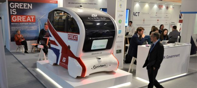 UN News/Yasmina Guerda An electric and driverless car displayed at the United Kingdom Pavilion at COP24, in Katowice, Poland. December 2018.