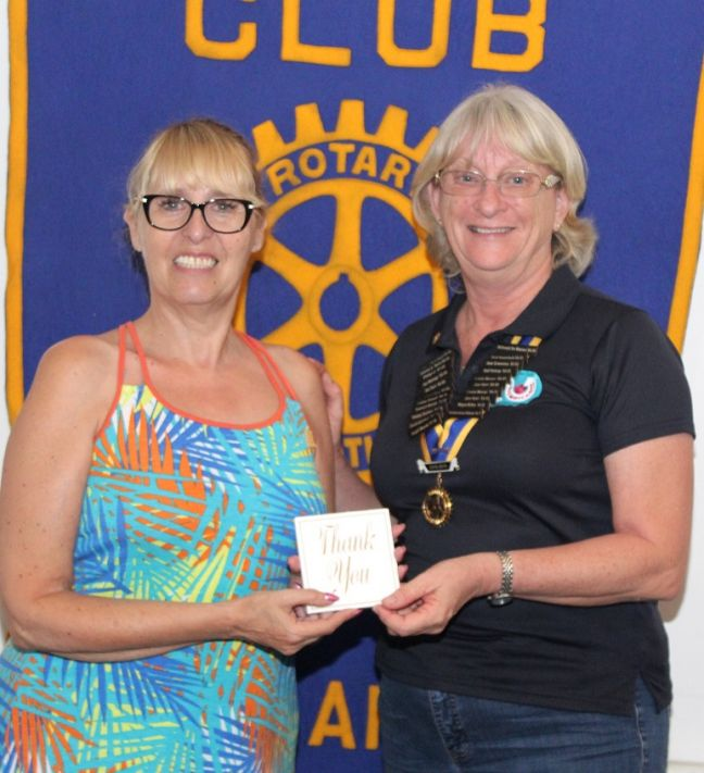 President Denise (R) gives Jacky Rom (L) a token of appreciation.