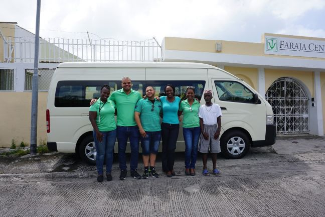 Donated bus with MHF team members and Faraja day treatment visitor, from left to right: Mrs. Valencia Hixon, Dr. Naeem Juliana, Mr. Benjamin Blijden, Ms. Giselle Codrington, Mrs. Mylene Martina and Mr. Trevor Wilson.
