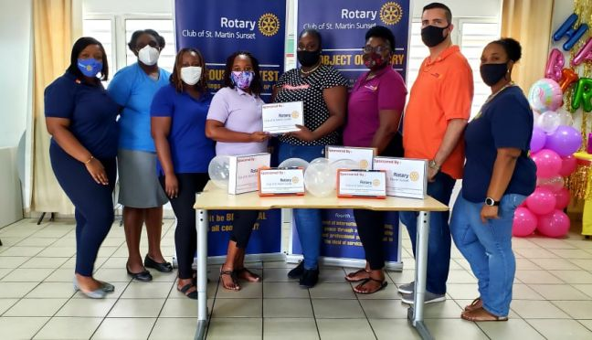 Members of the Rotary Club of St. Martin Sunset presenting tablet devices to the staff of Star After School Program at the Rupert Maynard Community Center.