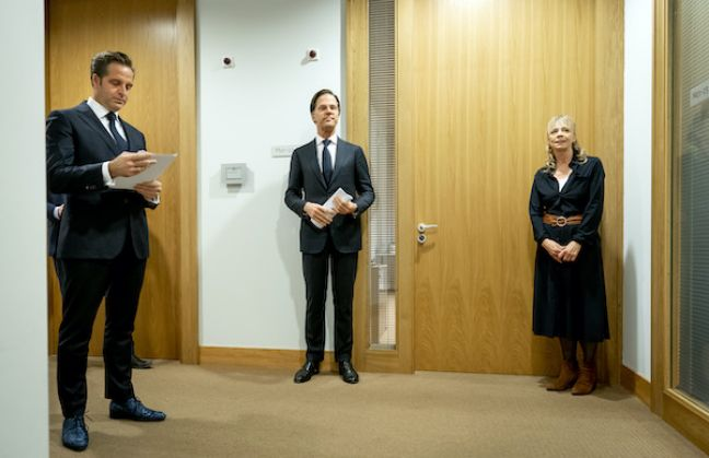 Prime minister Mark Rutte (c) and health minister Hugo de Jonge ahead of the press conference. Photo: Bart Maat  Read more at DutchNews.nl: