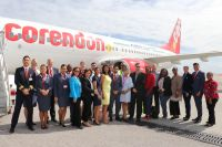 Minister Johnson (eight from the right) and Interim Director of the St. Maarten Tourism Bureau (STB) May-Ling Chun (ninth from the right) joins Insel Air, Halley Aviation Services, and Divi Divi Air/Corendon representatives at SXM Airport following inaugural flight from Curacao.
