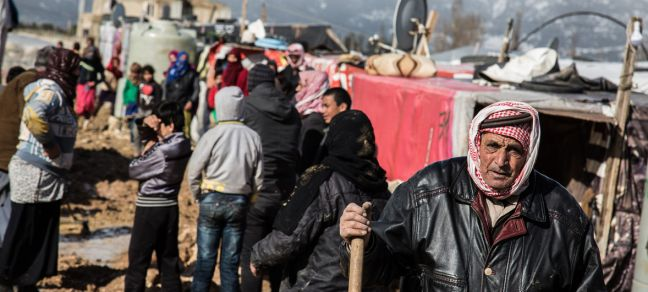 UNICEF/UN0158355/Halldorsson Syrian refugees gather outside their shelters following a winter storm which brought rain and snow, at an informal settlement in Haoush Harime, in Bekaa Valley, Lebanon.
