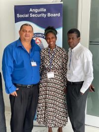 Ms. Shadyra Francisca (BearingPoint Caribbean Associate Director and Country Leader Sint Maarten) joined by (L) Mr. Timothy A. Hodge (Director, Anguilla Social Security Board) and (R) Dr. Irad Potter (Delegate Government British Virgin Islands).