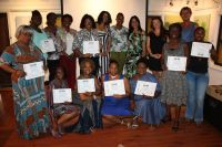 In the picture: Representatives of the sponsors Fleur Hermanides and Marjan de Visser, Teacher Diana Lebacs, coach Yvonne Dick, Project leader Ingrid Holaman and BKE's chair lady Loekie Morales with 9 of the certificated storytellers: From left to right first row: Mariland Powell, Patricia Jardine Peters, Rita Carty, Tracey Aaron, Gloria Francis, Dorita Ward, Getsy Moreno. Second row standing: Monika Kluis and Linda Moise Flanders. Photo Credits: Alphonso Blijden.