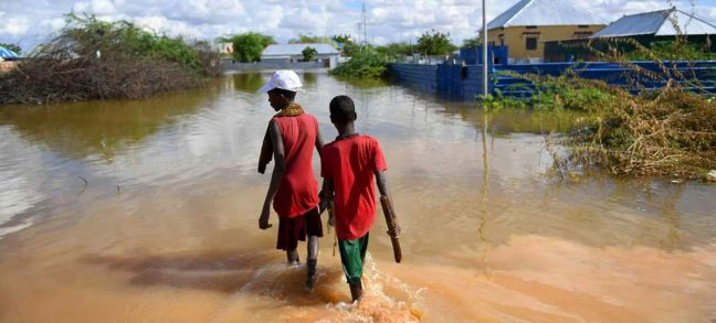 UN Photo/Ilyas Ahmed Young boys walk through a section of a flooded residential area in Belet Weyne, Somalia.