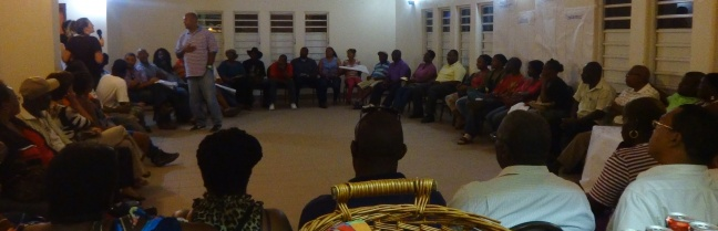 Residents participating in a community dialogue session.