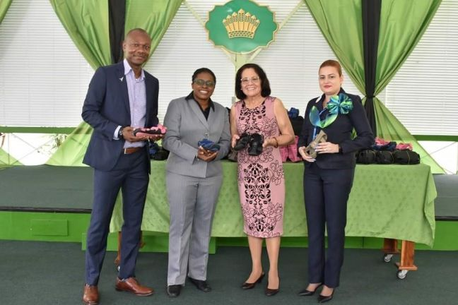First Lady, Mrs. Sandra Granger (second from right) is joined by Caribbean Airlines, Head of Corporate Communications, Ms. Dionne Ligoure; Sales Executive, Guyana-Suriname, Mr. Dion Inniss and Ticket Office Supervisor, Ms. Stephanie Greene at a brief presentation ceremony to hand over the 'Shoes that Grows' which the airline transported at no cost.