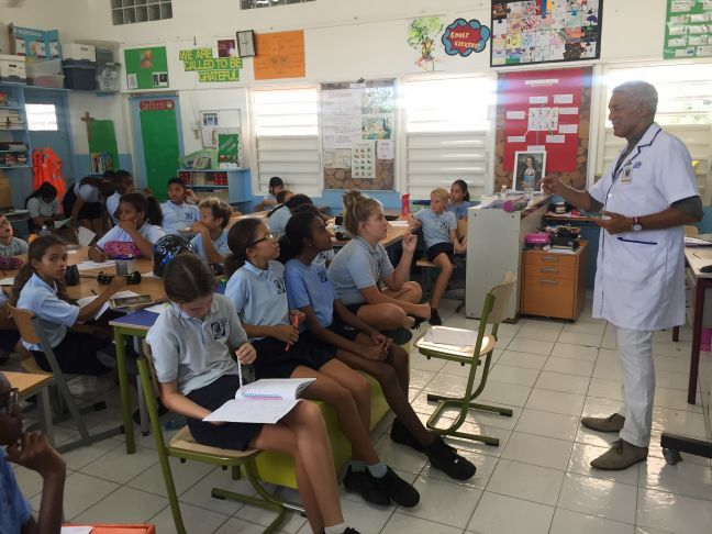 SMMC ENT specialist Dr. Dick Wong Chung lecturing the students of Group 7 and 8 of Sr. Regina Primary School.