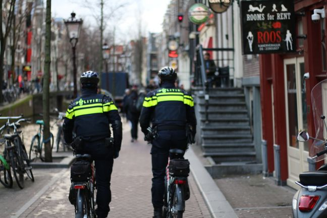 Police tour the red light district during the day, when it is quieter. Photo: Graham Dockery